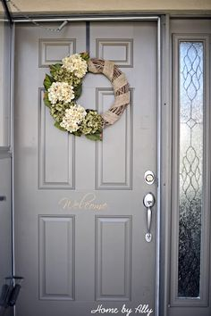 Front door vinyl & cute wreath dress up any door. Cute colors for fall too.
