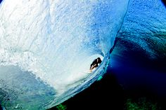 Behind the curtain look at Danny Fuller riding a perfect Teahupo'o barrel in Tahiti. Photo by Zak Noyle