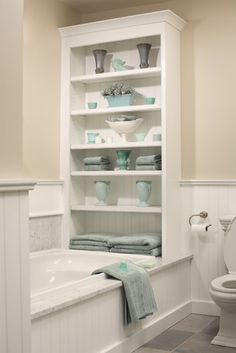 A neutral bath with turquoise accents. Love how the colors can be changed--but the wall colors stay the same.
