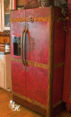 An old textured refrigerator turned into a vintage steamer trunk. SK Sartell