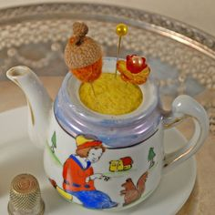 pincushion in a toy teapot