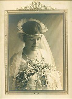 Bride, circa 1910s. Interesting head piece.