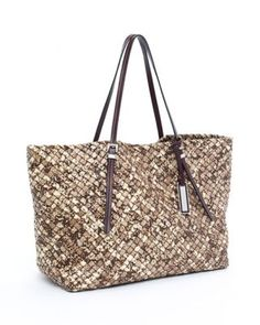 Do not start your vacation without this! Michael Kors Safari woven tote.