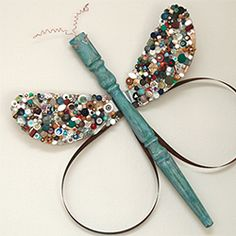 DIY Butterfly and Dragonfly folk art made with table legs and fan blades.