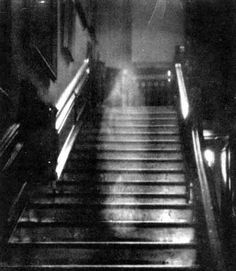 """""""One of the most convincing  photographs was the famous image of the 'Brown Lady' of Raynham Hall in Norfolk, England. The photo was taken by Captain Provand, a professional photographer, who was taking snapshots of the house for Britains Country Life magazine in September 1936. His assistant, Indre Shira, actually saw the apparition coming down the staircase and directed Provand to take the photo... even though the other man saw nothing at the time. The resulting image (shown here) has been ..."""