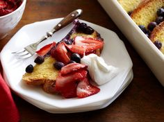 Blueberry French Toast Casserole with Whipped Cream and Strawberries from FoodNetwork.com