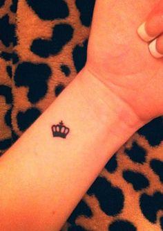Crown tattoo behind ear?