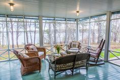 Beautiful screened porch; note ceiling and light fixtures; Judy Blume House for Sale - Martha's Vineyard Home - Country Living......