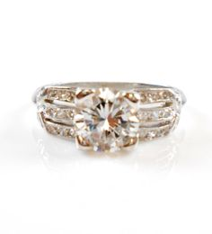 Very similar to one lower on the page that I really loved. Top choice overall but def at the higher end of the price range <3. Price/value ratio is solid. But still on the expensive side. Not gold but love the shape! Platinum Art DECO 1.20 CT  $6500.00