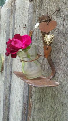 This vintage rustic hoe & jar, tied up nicely with rusted wire, hearts & Victorian buttons makes such a charming flower vase!