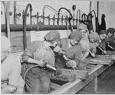Women workers in ordnance shops, Midvale Steel and Ordnance Company, Nicetown, Pennsylvania. Hand chipping with pneumatic hammers., 1918. National Archives Identifier: 530774.