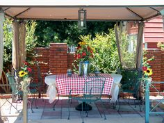 Gazebo at pool side.  Details included personalized arrangement and lights strung under canopy for nightfall lighting.
