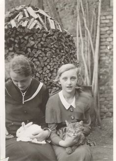 Two German Girls, a Rabbit and a Cat. From the collection of flickr member mrwaterslide