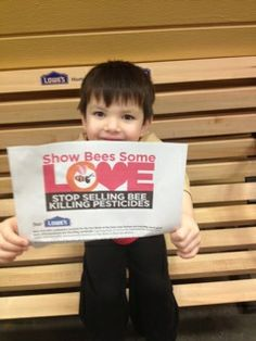 """Four year old Julian wants a future filled with a just agricultural system. He urged Lowe's to """"show bees some love"""" and stop selling bee-killing pesticides by delivering this valentine."""