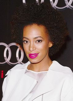 Solange Knowles in a punchy pink lip