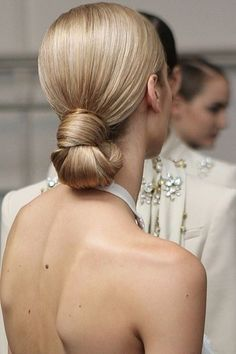 Low, smooth, knotted bun at the nape of the neck: Hair perfection.