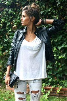 distressed jeans. white t-shirt. black leather jacket. bun.