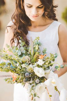 tropical wedding bouquet, photo by Julie Shuford Photography http://ruffledblog.com/tropical-malibu-inspiration #weddingbouquet #flowers