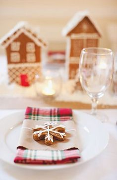 Ginger bread house center pieces with candles, and cookie favor.
