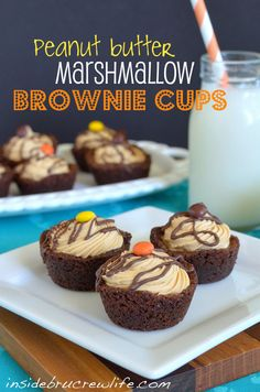 Peanut Butter Marshmallow Brownie Cups - fudge brownie cups filled with a peanut butter nougat filling and topped with Reeses pieces. You will eat more than one!!! #peanutbutter #brownies www.insidebrucrew...