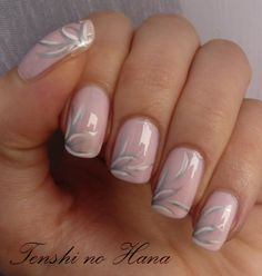 Nail art, pink with white and silver stripes