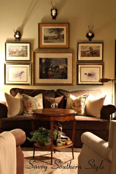 English country mix room, roe deer antlers, gallery wall, equestrian and dog prints, velvet sofa, leather chair