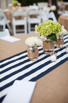 table runner and burlap on vases