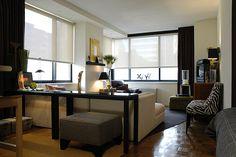 Sleek and chic studio apartment layout.
