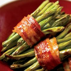 Bacon-wrapped Green Bean Bundles with Sweet Vinagrette.-This is what I make for a  green vegetable side dish at Thanksgiving.--Sooo good!!-Use the partially cooked bacon that you would buy to cook in the microwave. It will crisp up faster in the oven so your green beans won't dry out.