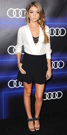 """The black-and-white color palette of the Modern Family star's Alice + Olivia romper says """"business,"""" but the exposed lace bra, girls' night out sandals and sultry fishtail braid say """"I'm here to party"""" (which she is, at the Audi pre-Emmys event in L.A.)."""