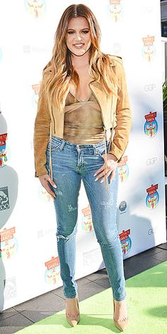 """KHLOÉ KARDASHIAN The West Coast-based reality star tries her hand at dressing like she's from the Wild Wild West instead, wearing a suede cropped jacket and distressed skinnies for a DreamWorks """"Adventure to Santa"""" event in Glendale, Calif."""