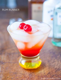 Rum Runner - Ingredients:  1 part Captain Morgan Spiced Rum  1 part Barcardi Light Rum  1 part Malibu Rum  1 part Disaronno Amaretto  4 parts pineapple juice, or more/less to taste (or a combination of pineapple & orange juice, or pineapple & mango juice)  grenadine, drizzled generously Shake it all together.