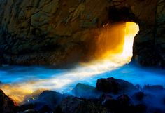 """The door at Pfeiffer Beach, Big Sur, California -- The sun only shines through this natural 'door' at just the right angle to create a beam of light, for two weeks out of the year–one week before and one week after the winter solstice. . ."""""""