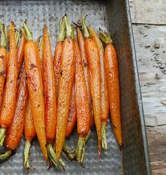 Simple Roasted Carrots      Line a baking sheet with parchment. Place the carrots on the pan and drizzle with olive oil. Toss to coat evenly. I added some fresh thyme and then sprinkled generously with salt and pepper.