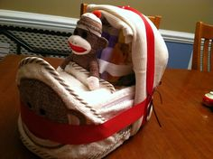 Sock Monkey Baby Shower Decorations | Sock monkey Diaper bassinet | baby shower planning ideas