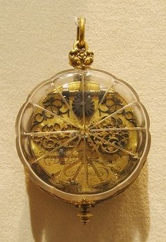 Watch. Watchmaker: David Buschman  (1626–1701). Probably after 1657. German (Augsburg). Case: rock crystal and gilded brass; Dial: gilded brass and silver, partly gilt; Movement: gilded brass and steel, partly blued