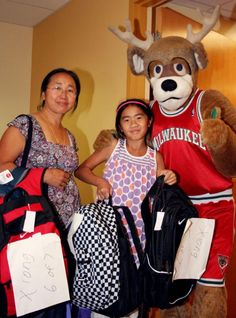 Bango stopped by the House of Peace to assist with backpack and school supply distribution. Bucks employees donated more than 800 school supply items, including notebooks, binders, pencils and crayons for this year's House of Peace Back to School Drive.