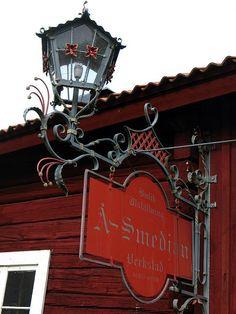 sign for blacksmith, Dalarna, Sweden