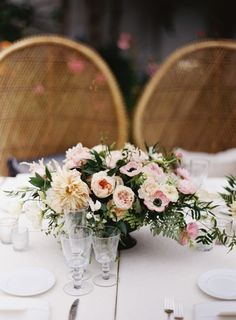 Beautiful, lush floral arrangement, with blush Dahlias, Garden Roses, Anemones, and rustic greenery. #wedding #flowers
