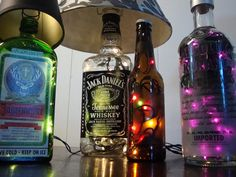Liquor Bottles and LED lights DIY...OMG something I can do with all our really pretty empty liquor bottles!! lol