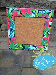 Painted & Framed Cork Board - Love this little bulletin board. Easy diy with Lilly wrapping paper or old agenda pages! #dormdecor