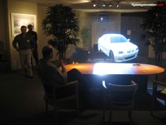 """Any other screen message on video isn't a touch on that. They are in front of you – none of this flat screen or plasma screen – they are really there."" This picture from FLY AWAY shows how they are using 3D projectors for showing a car to the client."