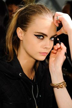 makeup trends, beauty tips, straight hair, eye makeup, tiger, cat eyes, black cats, cara delevingne, anna sui