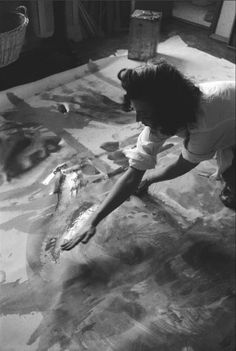 USA. New York City. 1957. Painter Helen Frankenthaler works on an Abstract Expressionist painting in her studio.