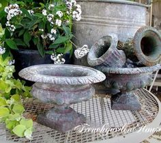A collection of French urns add such character to any garden.