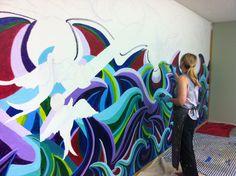 Painting a mural of ocean waves