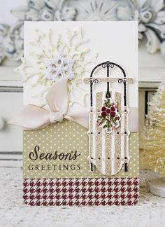 by Melissa Phillips: Lilybean Paperie PTI: Two Feet Deep stamps (sled), Fancy Flakes dies, Polka Dot Basics Stamps (snowflake dots-Spring Moss ink- coated w-glitter/ layer together-top w-resin snowflake.