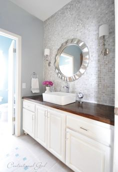 Gorgeous mosaic tile wall and statement mirror.