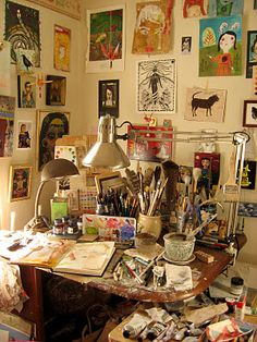 lynn Hoppe's studio - Love the inspirations all over the walls and the materials right there on hand!