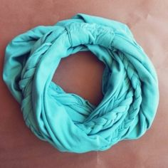 A tutorial on how to make a braided loop scarf using jersey knit fabric